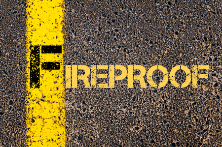 fireproof: Concept image of Business Acronym F as FIREPROOF written over road marking yellow paint line.