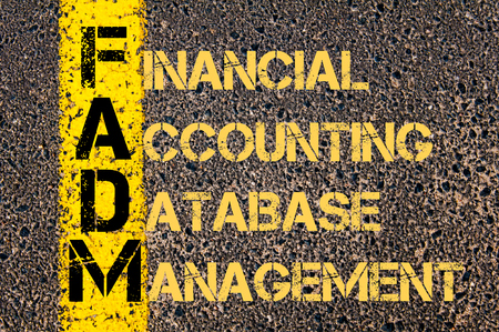 database management: Concept image of Business Acronym FADM as Financial Accounting Database Management written over road marking yellow paint line.