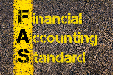 fas: Concept image of Business Acronym FAS as Financial Accounting Standards written over road marking yellow paint line.