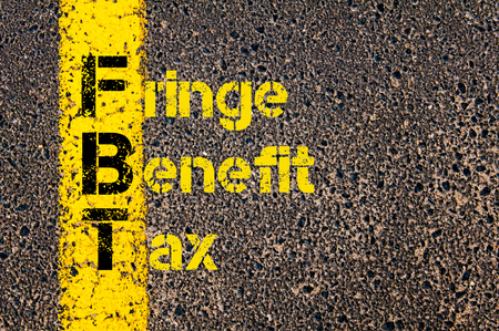 Concept image of Business Acronym FBT as Fringe Benefit Tax written over road marking yellow paint line.