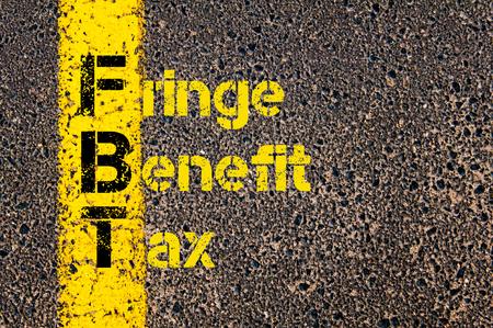 Concept beeld van bedrijf Acroniem FBT als Fringe Benefit Tax overschreven wegmarkering gele verf lijn.