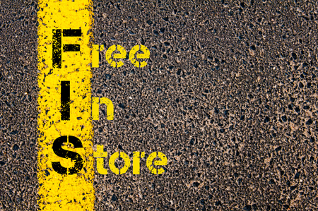 fis: Concept image of Business Acronym FIS as Free In Store written over road marking yellow paint line. Archivio Fotografico