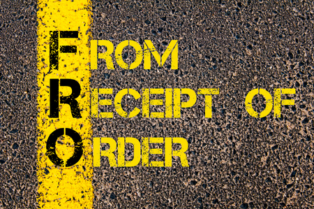 to and fro: Concept image of Business Acronym FRO as From Receipt of Order written over road marking yellow paint line. Stock Photo