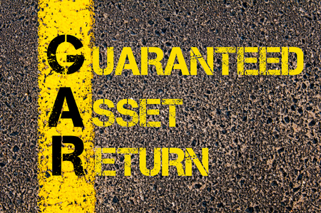 gar: Concept image of Business Acronym GAR as Guaranteed Asset Return written over road marking yellow paint line.