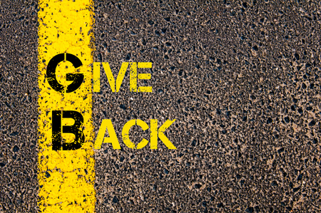 gb: Concept image of Business Acronym GB as Give Back written over road marking yellow paint line. Stock Photo