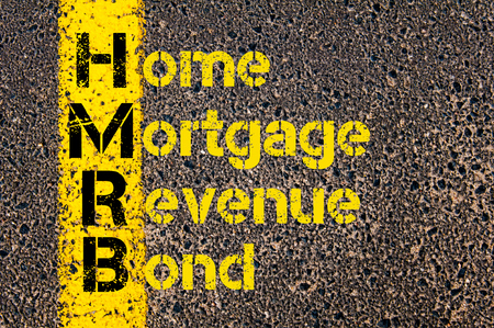 mortgage: Concept image of Business Acronym HMRB as Home Mortgage Revenue Bond written over road marking yellow paint line.