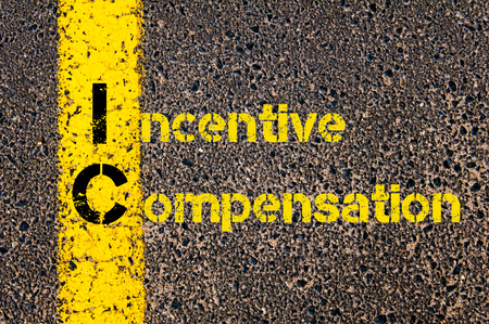 Ic: Concept image of Business Acronym IC as Incentive Compensation written over road marking yellow paint line. Stock Photo