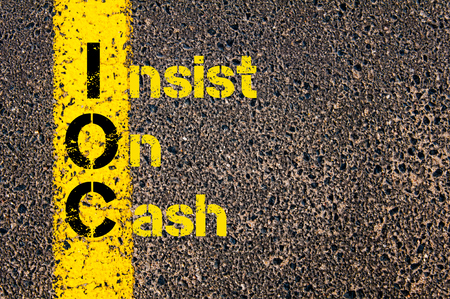 insist: Concept image of Business Acronym IOC as Insist On Cash written over road marking yellow paint line.
