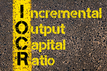 output: Concept image of Business Acronym IOCR as Incremental Output Capital Ratio written over road marking yellow paint line.
