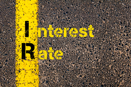 ir: Concept image of Business Acronym IR as Interest Rate written over road marking yellow paint line. Stock Photo