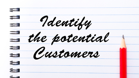 identify: Identify the potential customers written on notebook page, red pencil on the right. Motivational Concept image