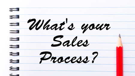 sales process: Whats your sales process? written on notebook page, red pencil on the right. Motivational Concept image