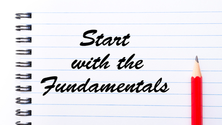 fundamentals: Start with the Fundamentals written on notebook page, red pencil on the right. Motivational Concept image Stock Photo