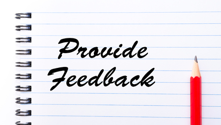 provide: Provide Feedback written on notebook page, red pencil on the right. Motivational Concept image