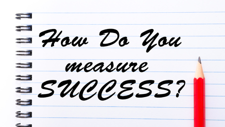 How Do You Measure Success? written on notebook page, red pencil on the right. Motivational Concept image