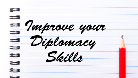 diplomacy: Improve Your Diplomacy Skills written on notebook page, red pencil on the right. Motivational Concept image