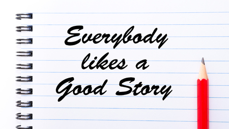 likes: Everybody Likes a Good Story written on notebook page, red pencil on the right. Motivational Concept image Stock Photo