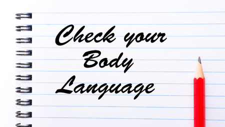 body check: Check Your Body Language written on notebook page, red pencil on the right. Motivational Concept image Stock Photo