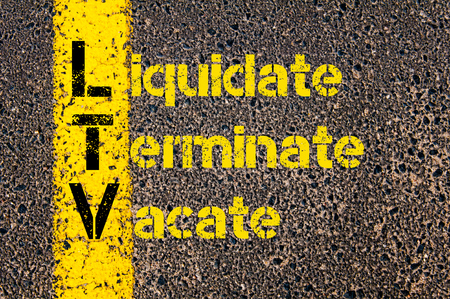vacate: Concept image of Business Acronym LTV as Liquidate, Terminate, Vacate written over road marking yellow paint line. Stock Photo