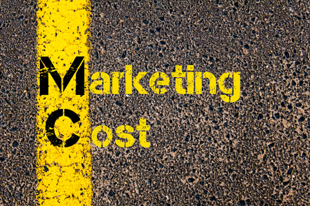 mc: Concept image of Business Acronym MC as Marketing Cost written over road marking yellow paint line. Stock Photo