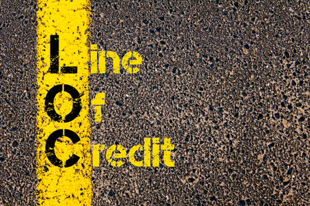 loc: Concept image of Business Acronym LOC as Line Of Credit written over road marking yellow paint line.