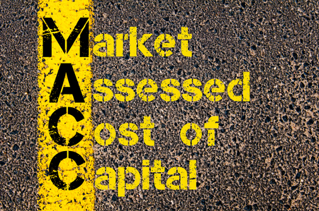 assessed: Concept image of Business Acronym MACC as Market Assessed Cost Of Capital written over road marking yellow paint line. Stock Photo
