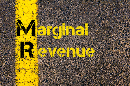 marginal: Concept image of Business Acronym  MR as Marginal Revenue written over road marking yellow paint line.
