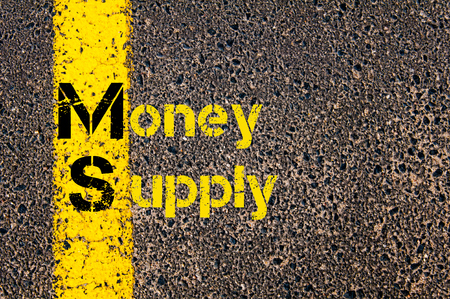 ms: Concept image of Business Acronym  MS as Money Supply written over road marking yellow paint line. Stock Photo
