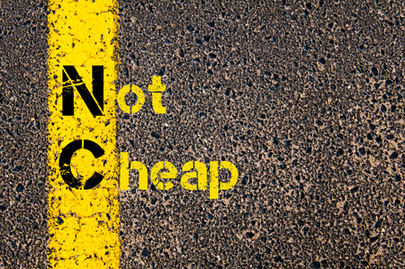 nc: Concept image of Business Acronym  NC as Not Cheap written over road marking yellow paint line.