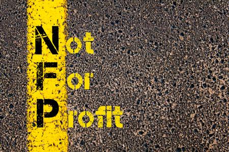 Concept beeld van bedrijf Acroniem NFP als Not For Profit overschreven wegmarkering gele verf lijn.