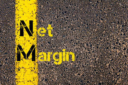 nm: Concept image of Business Acronym NM as Net Margin written over road marking yellow paint line.