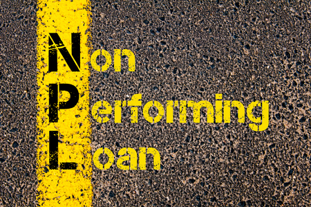 Concept image of Business Acronym NPL as Non Performing Loan written over road marking yellow paint line.