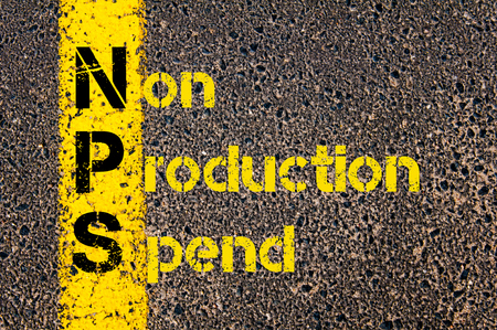 Concept image of Business Acronym NPS as Non Production Spend written over road marking yellow paint line.