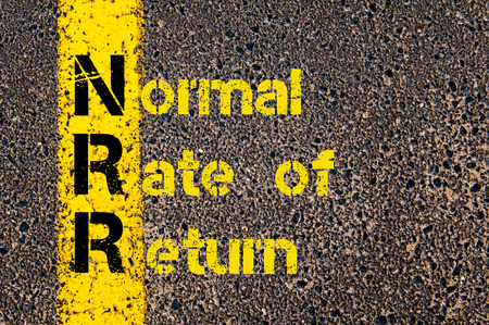 rate of return: Concept image of Business Acronym NRR as Normal Rate of Return written over road marking yellow paint line.