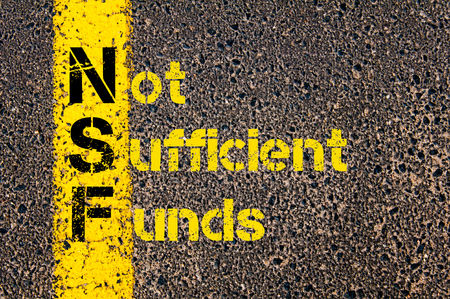 Concept image of Business Acronym NSF as Non Sufficient Funds written over road marking yellow paint line.