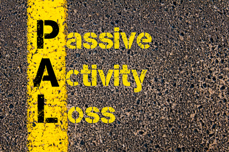 pal: Concept image of Accounting Business Acronym PAL Passive Activity Loss written over road marking yellow paint line.