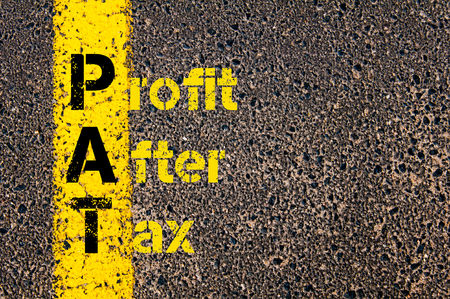 pat down: Concept image of Accounting Business Acronym PAT Profit After Tax written over road marking yellow paint line. Stock Photo