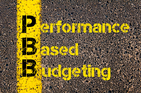 budgeting: Concept image of Accounting Business Acronym PBB Performance Based Budgeting written over road marking yellow paint line. Stock Photo