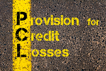 provision: Concept image of Accounting Business Acronym PCL Provision for Credit Losses written over road marking yellow paint line. Stock Photo