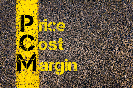 margen: Concept image of Accounting Business Acronym PCM Price Cost Margin written over road marking yellow paint line.
