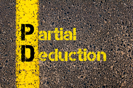deduction: Concept image of Accounting Business Acronym PD Partial Deduction written over road marking yellow paint line.