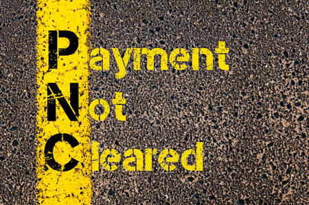cleared: Concept image of Accounting Business Acronym PNC Payment Not Cleared written over road marking yellow paint line.