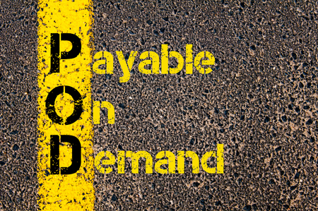 payable: Concept image of Accounting Business Acronym POD Payable On Demand written over road marking yellow paint line. Stock Photo