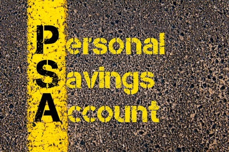 psa: Concept image of Accounting Business Acronym PSA Personal Savings Account written over road marking yellow paint line.