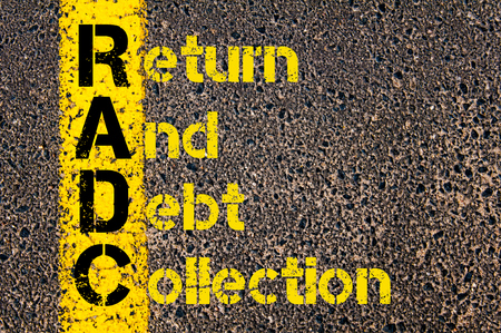 debt collection: Concept image of Accounting Business Acronym RADC Return And Debt Collection written over road marking yellow paint line.