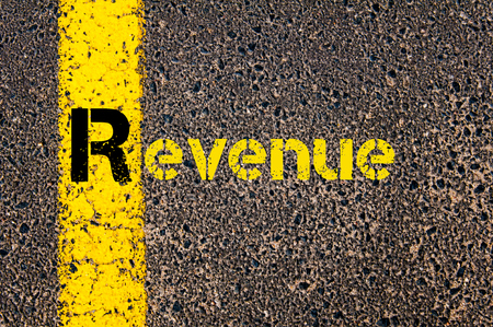 r image: Concept image of Accounting Business Acronym R Revenue written over road marking yellow paint line.