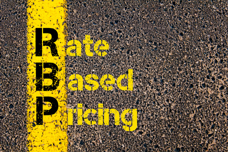 is based: Concept image of Accounting Business Acronym RBP Rate Based Pricing written over road marking yellow paint line. Stock Photo