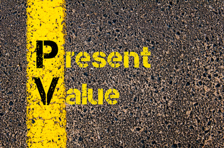 road marking: Concept image of Accounting Business Acronym PV Present Value written over road marking yellow paint line.