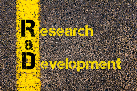 rd: Concept image of Accounting Business Acronym R&D Research And Development written over road marking yellow paint line.