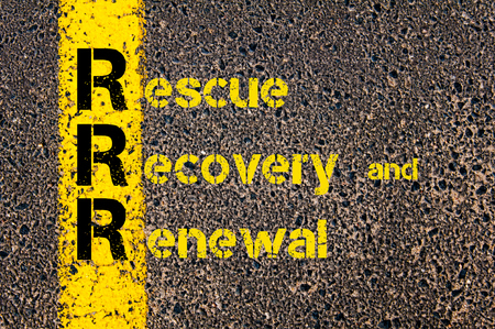 renewal: Concept image of Accounting Business Acronym RRR Rescue, Recovery and Renewal written over road marking yellow paint line. Stock Photo